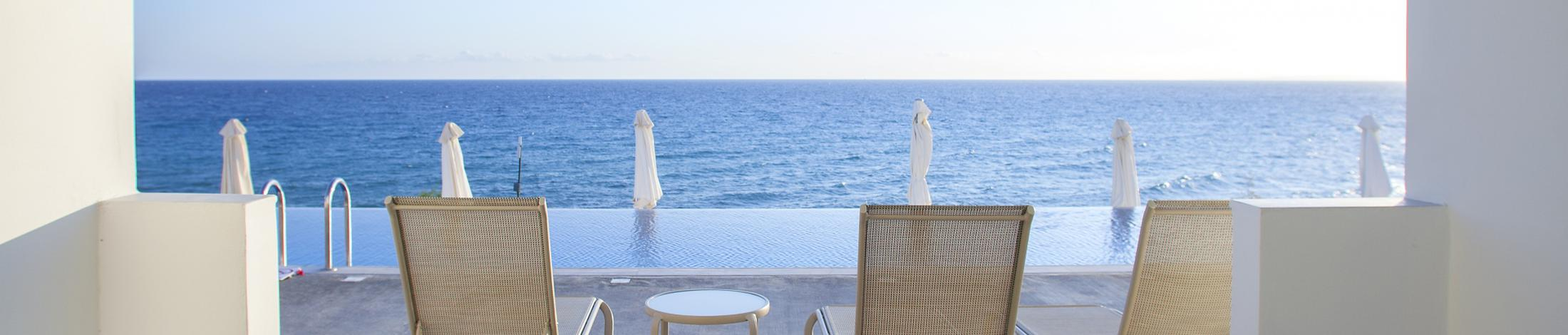 Family deluxe with shared pool and sea view plagos beach hotel  greece